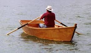 man in rowboat